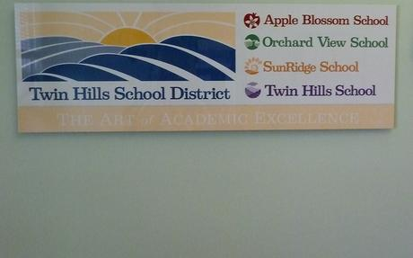 THUSD sign with all school logos.JPG